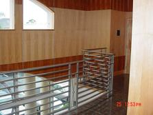 Curved Stainless Steel Railing installed in granite floor